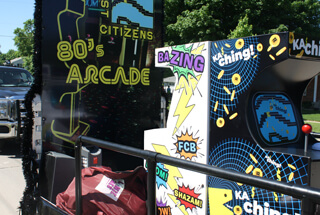 80s arcade parade float with BaZing and KaChing arcade games on them