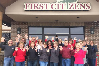 Mora First Citizens employees holding their 10 fingers up