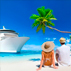 cruise ship at shore with palm tree and couple sitting in sand